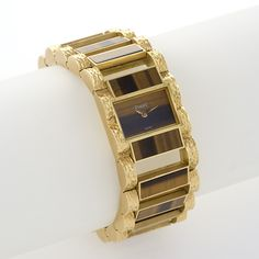 A French Mid-Century 18 karat gold watch with tiger's eye by Piaget.