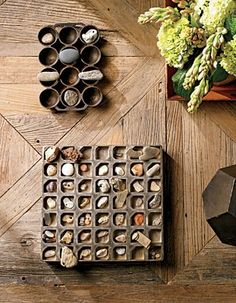 Beach rocks are displayed in an antique muffin pan and a candy mold on the coffee table.