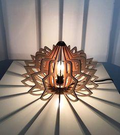Le Luminaire Lotus sinspire de la nature pour vous donner une ambiance végétale, qui transforme vos espaces de vie en un havre de paix.  Luminaire 100% bois. Fabriqué en France. Edition limitée  dimensions : 25 cm x 35 cm 10 x 14 inches