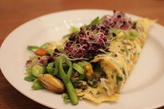 Sea breeze omelet. Made with sea weed, mussels, herbs, and scallions.