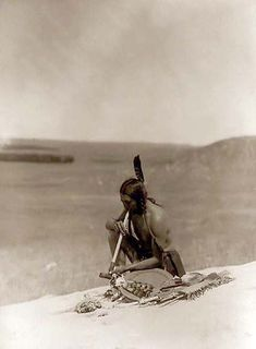 This Cheyenne indian, smoking a peace pipe, appears to be meditating on a rock known as Medicine Rock. It was taken in 1907 by Edward S. Curtis. We have created this collection of images primarily to serve as an easy to access educational tool. Contact curator@old-picture.com. Image ID# 3A47B36D