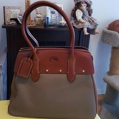 """Dooney Bourke Large Wilson Bag 13"""" wide 10"""" high 7"""" deep 8"""" shoulder drop fits nicely over shoulder and under arm.  Taupe color pebbled leather one side has a softer leather finish, see pictures.  Clean inside with the exception of a pen mark in the inner zipper compartment see picture. Dooney & Bourke Bags Shoulder Bags"""
