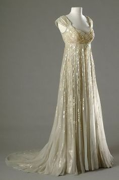 Merle Oberan wore this gorgeous champagne-colored empire gown in the 1954 movie DESIREE.jpg