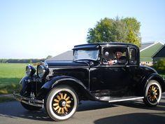 dag meneer in de mooie Zwarte Auto.. eigen bayke foto.