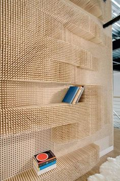 wooden peg bookcase. It might be interesting to cover a peg board in felt and then perforate it for pegs. The pegs could create shelving or designs. The pegs would also work as diffusers in a room that is acoustically too flat or dead.