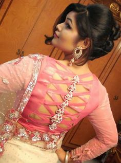 F you're wondering about the latest lehenga blouse designs, you've reached the right spot. A designer lehenga blouse can make your look fresh from fashion Blouse Back Neck Designs, Netted Blouse Designs, Fancy Blouse Designs, Saris, Net Blouses, Stylish Blouse Design, Designer Blouse Patterns, Lehenga Blouse, Collor