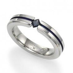 4mm titanium ring with blue coloring and princess cut blue sapphire