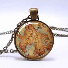 Peter Pan Neverland map  antique bronze necklace Peter Pan jewelry Round bezel resin pendant , fairy fantasy jewelry. $11.95, via Etsy.