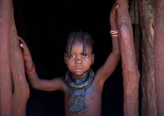 Himba kid in his house - Angola via Flickr
