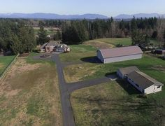 Equestrian Estate for Sale in King County in Washington. Stunning shy ten-acre estate with two residences plus dream barn/shop with 800 sq ft apartment! Grand entry Main Residence features an open design with timeless circular floorplan, four bedrooms, bonus room and four bathrooms including three with showers.