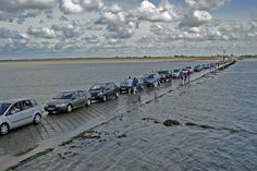 This is the Passage du Gois in France, connecting the Gulf of Burnёf and the island of Noirmoutier. It can only be used twice a day for a few hours at a time because it disappears underwater during high tide.