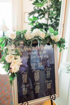 The Thursday Club Floral escort card display garland  by San Diego wedding florist, Compass Floral.