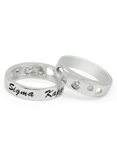 """Sigma Kappa Sterling Silver Ring with Hearts and Cubic Zirconias.  Engraved with """"Sigma Kappa"""" in an elegant cursive writing, filled with black enamel. The other side is set with 3 cubic zirconia and cut outs in the shape of hearts. Finished with rhodium for a brilliant, lasting shine.  The perfect gift for that special big or little sister or even yourself! Comes in a nice gift box."""