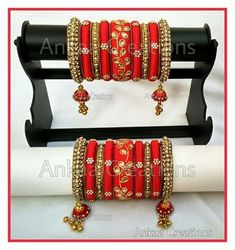 Beautiful, grand bridal bangles..zardosi work done on center kada bangles and stone work done on side bangles..jhumka hangings at the border bangles gives an extra touch..plz visit https://www.facebook.com/ankaa.creations and give us a like..thank you :)
