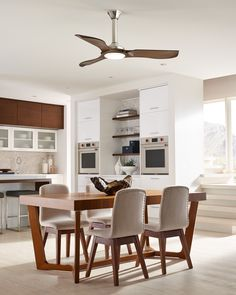 """Sleek and modern, the 56"""" Minimalist ceiling fan by Monte Carlo has three Balsa wood blades with soft, rounded lines inspired by a mid-century aesthetic while still feeling completely contemporary.  An integrated, 16W LED downlight bolsters its efficiency and the DC motor provides powerful airflow. ENERGY STAR.  #MonteCarlo #ModernCeilingFan #LivingRoom #DiningRoom #LEDLighting"""