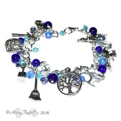 "Blue Magical charm bracelet. This pretty charm bracelet was made with a large number of Tibetan silver charms, glass and acrylic beads on a silver plated chain bracelet. Charms include many of the things you associate with magic :) including a witch/wizard hat, tree of life, witch, howling wolf, broomstick and cat. The beads are a good mix of glass and crystal and glass in shades of blue frosted glass and bright cobalt glass. This will fit wrists up to 7"" but if larger is needed an extender…"
