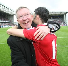 Two @manutd greats – Sir Alex Ferguson and Ryan Giggs – share a hug after securing the club's 19th league title.