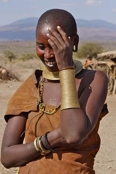 Brass neck arm cuffs,Africa | A Datoga woman from Tanzania