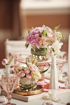 Beautiful vintage chic pink depression glass, pink roses, and white vases