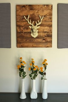 DIY faux stag head wall art! I can't believe how easy this was to make! The stripe pieces on the side were also DIY's. #prettyprovidence