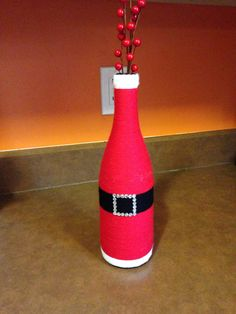 Up cycled wine bottle- Santa's belly. Made of wine bottle, yarn, Modge Podge, and rhinestones