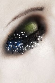 Interesting rhinestone work. Would think it uncomfortable to wear stones on that part of the upper lid though.