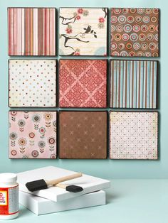 Display Your Papers - Mod Podge your favorite scrapbook paper (or fabric remnant) to black canvas box squares | BHG
