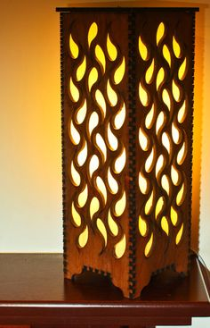 Decorate your home with this beautiful laser cut table lamp. This item is laser cut from hand stained 1/4 plywood with a deep mahogany finish. Lamp uses