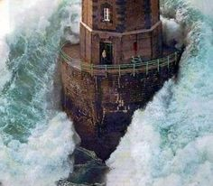 Jean Guichard is a French photographer best known for his lighthouse photographs. This lighthouse is off the coast of Brittany, France. Please know, the man in the lighthouse tower was/is still alive after this horrific wave crashed upon it.