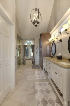 A bathroom remodel in Traverse City, Michigan, created a space fit for royalty! Angela Goodall, a designer with Kitchen Choreography, took this bathroom to new heights with Fieldstone Cabinetry's Roseburg door style in Maple finished in a custom cabinet color created with Fieldstone Cabinetry's Villa White and Nickel glaze. The furniture-style armoire was also created with the Roseburg door style, this time in Cherry finished in a darker cabinet color called Cappuccino.