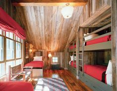 rustic children's room with wood paneling and bunk beds