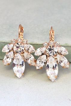 Bridal Earrings,Bridal drop earrings,Crystal drop earrings,Swarovski crystal drop earrings,Rose gold earrings,Bridal Diamond droplets Swarovski Crystal marquis crystals and diamond cut crystal with vintage glam appeal available in Rose gold or Oxidized Silver. Petite Delights is an Official SWAROVSKI® Branding Partner Official Swarovski Elements® Partner Made with real genuine high quality Austrian Swarovski ©Crystal .  Details : ♥ U.S packages shipped via USPS® insured+USPS® tracking number…