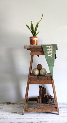 vintage tiered wood shelf / industrial standing pyramid shelving / bookshelf, furniture by wretchedshekels on Etsy https://www.etsy.com/listing/190222274/vintage-tiered-wood-shelf-industrial