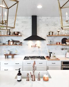 Black white and brass = Perfection. #kitchengoals Found the black hood for under $300 http://cpycat.ch/2tHqGsk via @stephaniewatts #CopyCatChic