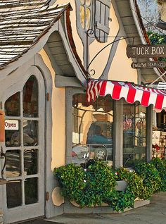 tuck box in carmel, california. hugh comstock, not a trained architect or designer, designed a quirky, uneven cottage for his wife, a dollmaker, and the rest of the town's residents wanted more, including this little shop. i LOVE it.