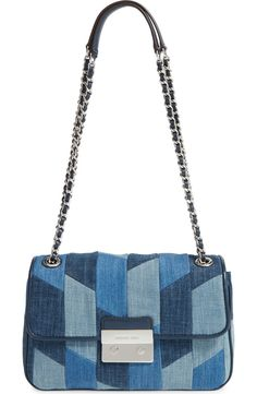 Free shipping and returns on MICHAEL Michael Kors 'Large Sloan' Patchwork Denim Shoulder Bag at Nordstrom.com. Patchworked denim gives a fun, boho twist to a classic shoulder bag outlined in lambskin leather piping. The pull-through chain strap can be worn doubled or pulled all the way through for crossbody styling.