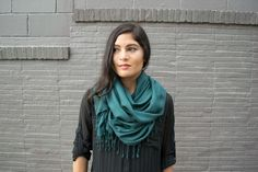This lightweight, dark green scarf was handcrafted by a weaver in Cambodia. The silky texture of the cotton gives your casual look a touch of luxury.