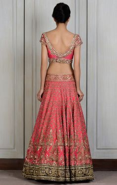 This Pink raw silk lengha intricately hand-embroidered zardozi motifs all…