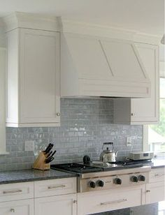 I have a real brick backsplash, (currently painted white) in our new place.  I could totally paint it a glossy blue like this! !  PROJECTS! !