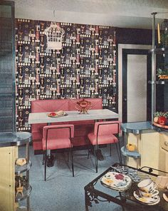 Fabulous wallpaper. Love the whole dinette area. Except that birdcage....