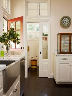 A Big Fan of Pocket Doors for Small Spaces {nice punch of orange on Dutch Door!}