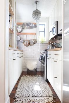 No matter what size your kitchen may be, you should put stock in the ability that an unexpected (and super stylish) light fixture can have to up the personality of your space. From eye-catching chandeliers to hard-working sconces, read ahead for unique kitchen lighting ideas (plus shoppable get-the-look comps) that will have you thinking twice about your outdated track lights.