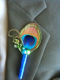 Peacock Boutonniere for your Peacock Wedding-Customize this Short Trim Around the Eye Boutonniere. $11.00, via Etsy.