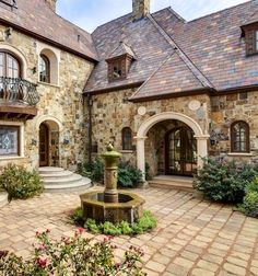 love the stone and the roof! cobblestone courtyard, too.
