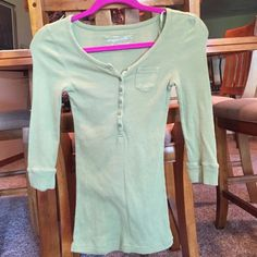 Aeropostale Green Henley Top This top buttons on the front and is a versatile olive green color. The fabric is robbed and the top has ribbon strap for easier hanging. Aeropostale Tops Button Down Shirts