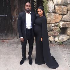 Kim Kardashian West wore a black Valentino cape gown to a weekend wedding with Kanye West. Kim Kardashian Kanye West, Estilo Kardashian, Kanye West And Kim, Kardashian Style, Kardashian Jenner, Kardashian Family, Kardashian Fashion, Kylie Jenner, Kardashian Photos
