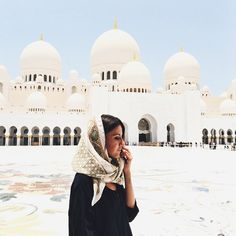 Traveling to the ivoried domes of the Sheikh Zayed Grand Mosque in Abu Dhabi.