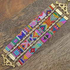 Nice three-strip wide cuff bracelet -- loom-woven beads - by Emidesh - this within one-bar-end construction. Chevron Armband, Chevron Bracelet, Bead Loom Patterns, Bracelet Patterns, Beading Patterns, Seed Bead Jewelry, Beaded Jewelry, Jewellery, Motifs Perler