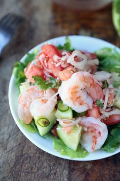 Memories of Thailand: an very simple and easy shrimp and cucumber salad with Thai chilies, fish sauce, tomatoes and shallots. Thai street food style.