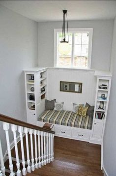 Make use of a large landing with built-in bookshelves and a tiny reading nook!